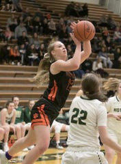 Brighton's Sydney Hetherton shoots the ball in a 43-41 loss at Howell on Friday, Jan. 17, 2020.