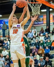 Brighton's Jacob Edwards pull down a rebound in a 52-48 overtime victory over Howell on Friday, Jan. 17, 2020.