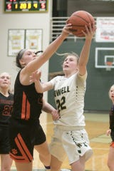 Howell's Maeve St. John (22) and Brighton's Sophie Dziekan (24) made the all-KLAA girls basketball team.
