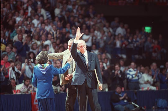 "Cawood Ledford, the ""Voice of the Kentucky Wildcats,"" waved to the Rupp Arena crowd after being honored yesterday. His wife, Frances, and UK Athletics Director C.M. Newton were behind him.