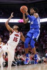 Kentucky Wildcats forward Keion Brooks Jr. (12) shoots as Arkansas Razorbacks guard Mason Jones (15) defends at Bud Walton Arena in Fayetteville, Arkansas, on Saturday, Jan. 18, 2020.