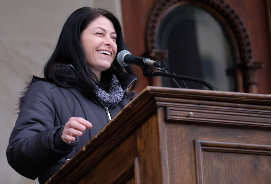 Michigan Attorney General Dana Nessel gets the crowd cheering with remarks at the Women's March at the Capitol in Lansing Saturday, Jan. 18, 2020. Despite the cold, rain and slushy snow serveral hundred people attended the event.