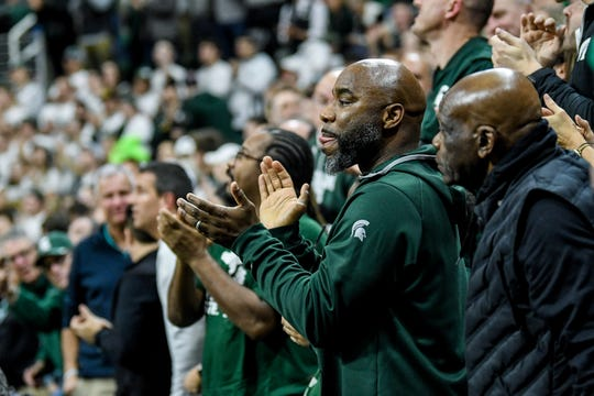 Former Michigan State great Mateen Cleaves claps after Cassius Winston pases Cleaves' Big Ten career assist record during the second half on Friday, Jan. 17, 2020, at the Breslin Center in East Lansing.