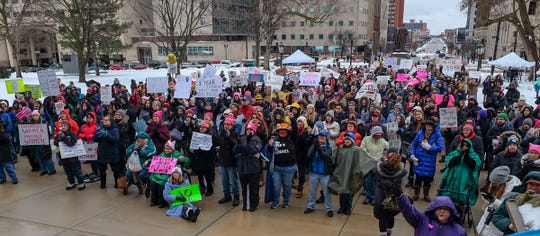 Despite the cold, rainy weather, several hundred people showed up for the annual Women's March at the Capitol Saturday, Jan. 18, 2020.