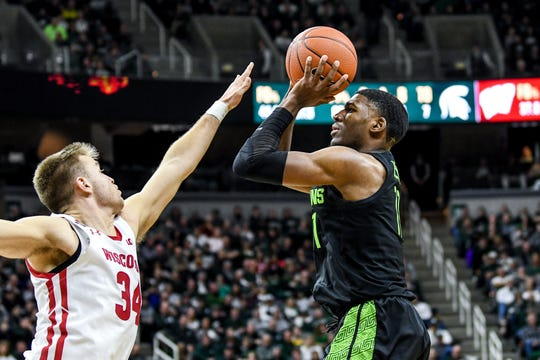 Michigan State's Aaron Henry, right, shoots as Wisconsin's Brad Davison defends during the second half on Friday, Jan. 17, 2020, at the Breslin Center in East Lansing.