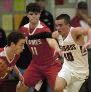 Mansfield Christian's Quinton Scott  tries to get around Loudonville's Jacob Gessner.