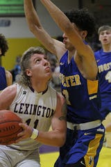 Lexington's Kaydan Berry drives on Wooster's Micah McKee in Friday night's Ohio Cardinal Conference basketball game.