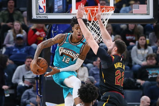 Cleveland Cavaliers forward larry Nance Jr. (22) defends against Memphis Grizzlies guard Ja Morant (12) on Jan. 17, 2020.
