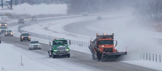 A snowplow leads traffic Saturday on I-41 in Lomira.