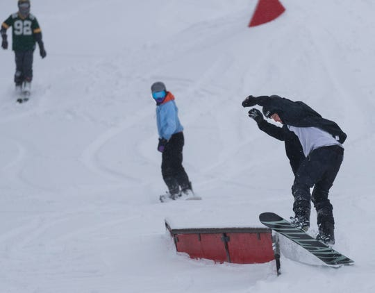 Skiers and snowboarders savor the fresh snow at Little Switzerland Ski Area in Slinger on Saturday, Jan. 18, 2020. A winter storm that started Friday evening had dumped as much as 7.5 inches of snow on some parts of the Milwaukee metro area by Saturday.