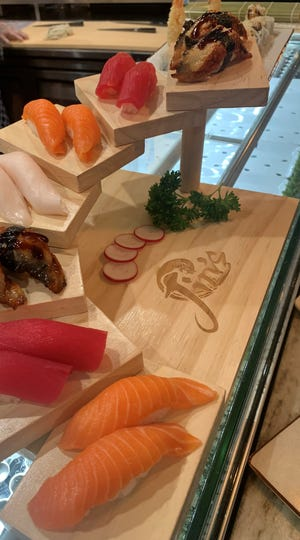"Nigiri sushi and other items served at Jin's Sushi Seafood & Bar, 7401 W. Barnard Ave. in Greenfield. Besides sushi, the restaurant has live scallops, oysters, sea urchin and lobster, and has an ""endless"" sushi option at lunch and dinner."