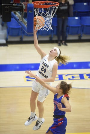 Mountain Home's Emma Martin skies for a layup during the Lady Bombers' win over Paragould on Friday night.