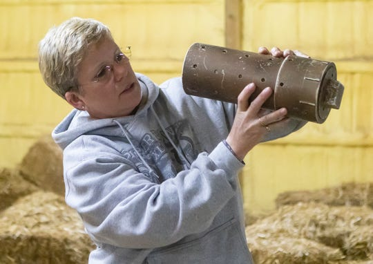 Denise King inspects a rat tube during the master trial of the barn hunt event held at CT Dog Services in Downsville, La. on Jan. 16