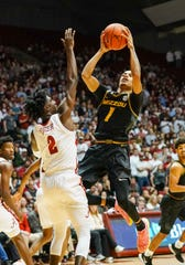 Jan 18, 2020; Tuscaloosa, Alabama, USA; Missouri Tigers guard Xavier Pinson (1) shots against Alabama Crimson Tide guard Kira Lewis Jr. (2) at Coleman Coliseum. Mandatory Credit: Marvin Gentry-USA TODAY Sports