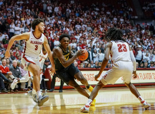 Jan 18, 2020; Tuscaloosa, Alabama, USA; Missouri Tigers forward Kobe Brown (24) drives to the basket against Alabama Crimson Tide forward Alex Reese (3) and guard John Petty Jr. (23)  at Coleman Coliseum. Mandatory Credit: Marvin Gentry-USA TODAY Sports