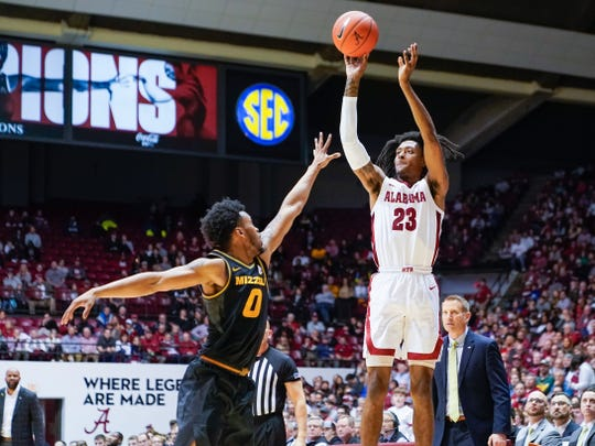 Jan 18, 2020; Tuscaloosa, Alabama, USA; Alabama Crimson Tide guard John Petty Jr. (23) shoots against Missouri Tigers guard Torrence Watson (0) at Coleman Coliseum. Mandatory Credit: Marvin Gentry-USA TODAY Sports