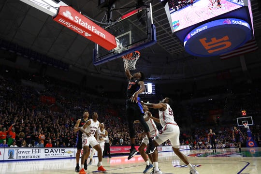 Florida forward Omar Payne (5) tips the ball in against Auburn during the first half at Exactech Arena on Jan. 18, 2020.