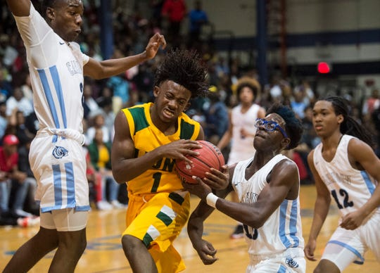 Central-Hayneville Travell McReynolds (1) drives the lane at Calhoun High School in Letohatchee, Ala., on Saturday, Jan. 18, 2020.