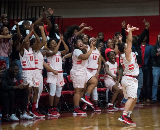 Lee's Alyah Postma (22) celebrates after hitting a three-pointer in overtime against Jeff Davis at Robert E. Lee High School in Montgomery, Ala., on Friday, Jan. 17, 2020. Lee defeated Jeff Davis 72-56 in overtime.