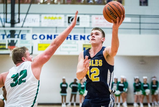 Delta's Brady Hunt goes up for a lay up against Yorktown during their game at Delta High School Friday, Jan. 17, 2020.