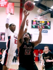 Riverdale's Javon Nelson (23) shoots the ball as Oakland's DD Anderson (23) guards him on Friday Jan. 17, 2020, at Oakland.