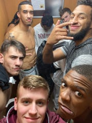 New Mexico State players pose for a photo on Friday, Jan. 18, as they are trapped inside a hotel elevator in Seattle, Washington.
