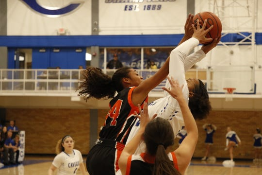 Artesia's Elliot Harrison blocks Carlsbad's Allie Myers on Jan. 17, 2020. Harrison was one of two Lady Bulldogs named to a District 4-4A team.