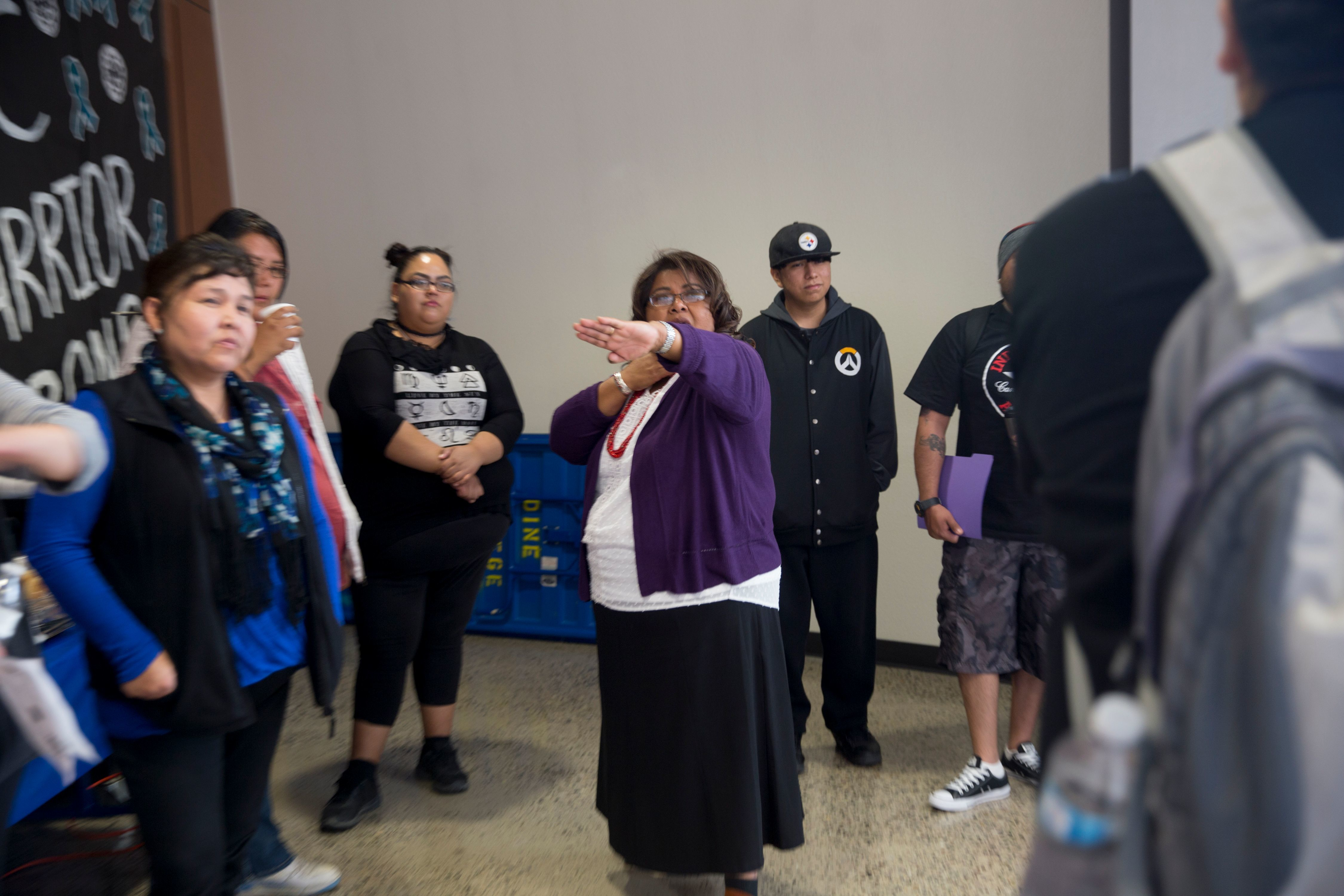 Diné College employee Lavine Blackmountain addresses a question to self-defense instructor Donny Moore during a sexual assault awareness and prevention conference on April 12, 2018 at the Sen. John Pinto Library at Diné College's south campus in Shiprock.