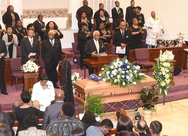 Hundreds gathered Saturday to mourn the passing of the Rev. Harry Richard, pastor of one of the three St. Landry Parish historically black churches destroyed by fire last year.