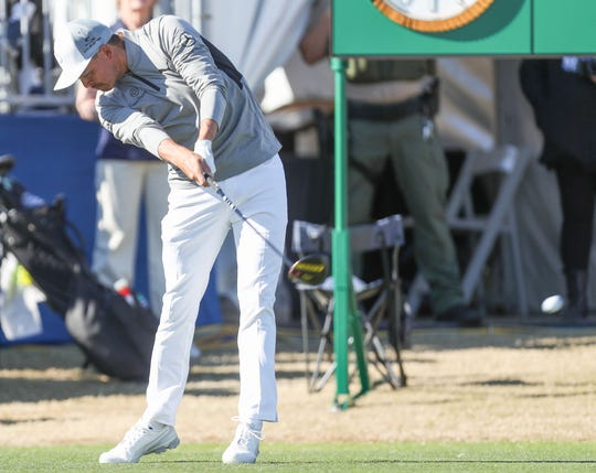 Rickie Fowler hits his first drive of the day on the first hole at the Stadium Course at PGA West in La Quinta, during the American Express golf tournament, January 18, 2020.