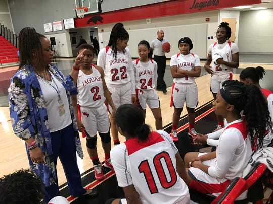West Florida head coach Ieasha Stallworth-Ridgeway instructs her team during a timeout against Pensacola High.