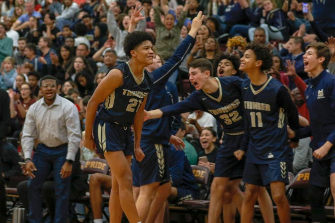The Desert Vista bench celebrates with guard Andrew King (21) after making a shot against Mountain Pointe on Jan. 17, 2020 at Mountain Pointe High School in Phoenix, AZ. (Brady Klain/The Republic)