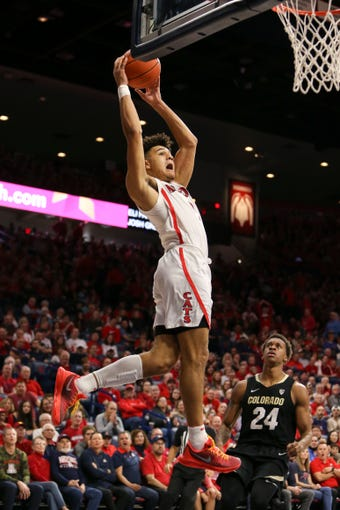 Jan 18, 2020; Tucson, Arizona, USA; Arizona Wildcats guard Josh Green (0) dunks the ball against the Colorado Buffaloes in the second half at McKale Center. Mandatory Credit: Jacob Snow-USA TODAY Sports