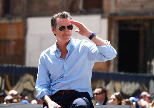California took a crack at challenging NCAA's hold on amateur status in September 2019 when Gov. Gavin Newsom signed a bill allowing California college athletes to profit from their likeness and image and hire agents. The new law is scheduled to take effect in 2023.