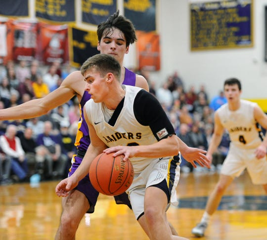 Elco's Braden Bohannon (40) tries to drive past Lancaster Catholic's Calan Titus (11) during the first quarter of action.