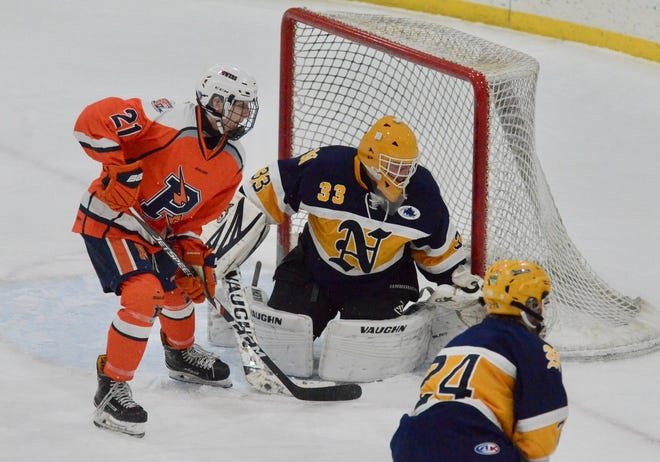 Port Huron Northern's Randy Falk watches for the puck against Flint Powers Catholic during a hockey game on Saturday, Jan. 18, 2020, at Flint Iceland Arenas