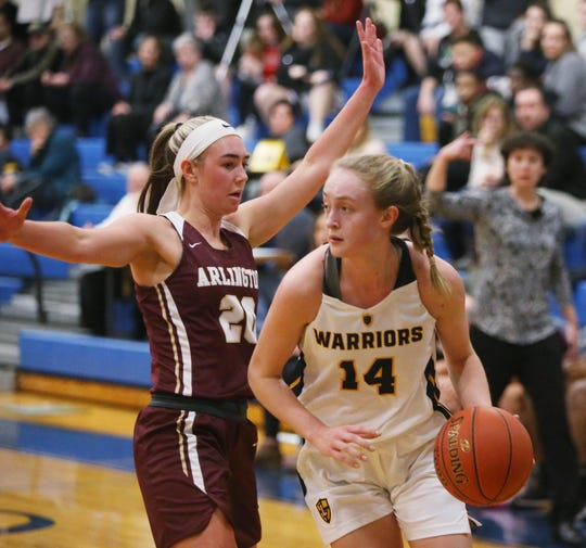 Lourdes' Ava Learn drives to the net as Arlington's Devin Schmidt during Friday's game in the Town of Poughkeepsie on January 17, 2020.