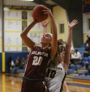 Arlington's Devon Schmitt goes up for a shot inside against Lourdes during a girls basketball game on Jan. 17.