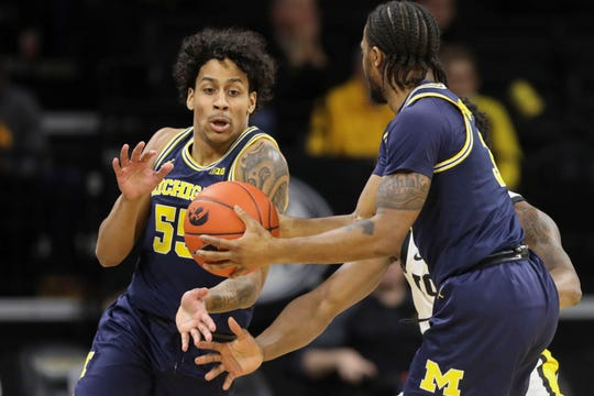 Michigan guard Eli Brooks (55) grabs the ball from guard Zavier Simpson (3) during the first half against Iowa in an NCAA college basketball game Friday, Jan. 17, 2020, in Iowa City, Iowa. (Rebecca F. Miller/The Gazette via AP)