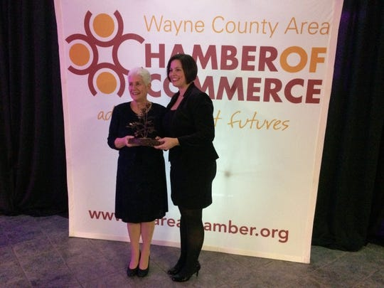 Katheryn Cruz-Uribe poses with Sherrilyn Johnson after Cruz-Uribe received the Art Vivian Distinguished Community Leader Award during the Wayne County Area Chamber of Commerce's annual dinner Friday, Jan. 17, 2020, in Kuhlman Center.