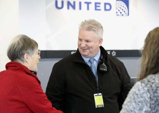 Tom Galbraith, center, wears two hats. He's the athletic director at Simpson University and works part-time as a customer service agent for United Airlines at the Redding Airport.