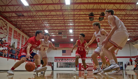 Josh Fava, far left, drives toward the basket for Christoval during a game against Miles on Friday, Jan. 17, 2020.