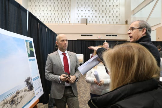 Salvo Vitale (far left) explains U.S. Wind's visual rendering to some Eastern Shore residents. The renderings were shown as part of the Maryland Public Service Commission's public hearing on offshore wind held on January 18, 2020 in the Ocean City Convention Center.