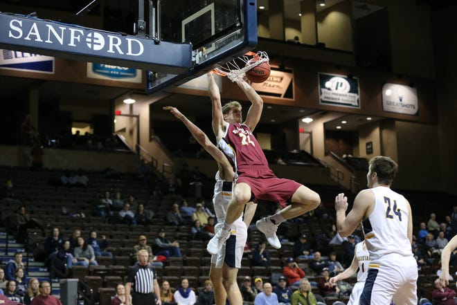 Northern State's Parker Fox throws down a dunk during his team's 82-77 win over Augustana Friday night at the Pentagon.