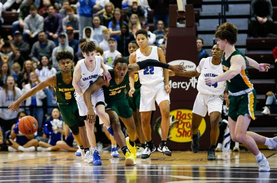 Greenwood's Grant Harper goes after a loose ball surrounded by Greensboro Day School's Brock Williams (5) and Bryce Harris (34) during the Bass Pro Shops Tournament of Champions at JQH Arena on Friday, Jan. 17, 2020.