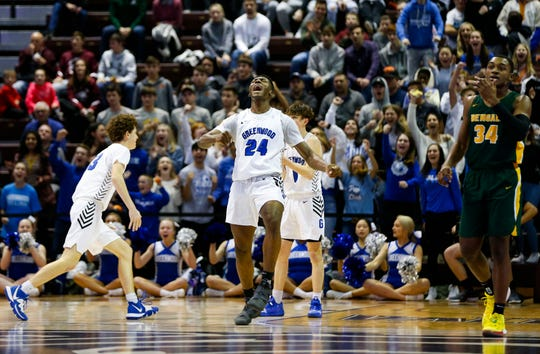 Aminu Mohammed celebrates after a foul gave the Greenwood Bluejays control of the ball with seconds left on the clock during a game against Greensboro Day School at the Bass Pro Shops Tournament of Champions at JQH Arena on Friday, Jan. 17, 2020.