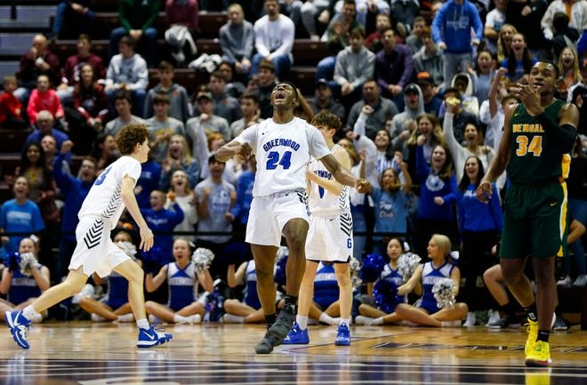 Aminu Mohammed celebrates after a foul gave the Greenwood Blue Jays control of the ball with seconds left on the clock during a game against Greensboro Day School at the Bass Pro Shops Tournament of Champions at JQH Arena on Friday, Jan. 17, 2020.