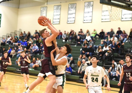 Stuarts Draft's Ethan Cash goes up for a shot in Fishersville Friday night, January 17.