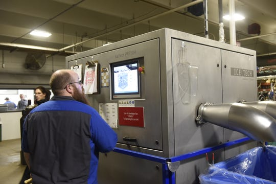 Branden Moffitt of Central McGowan prepares the machine that will cut the dry ice into dry ice rice.