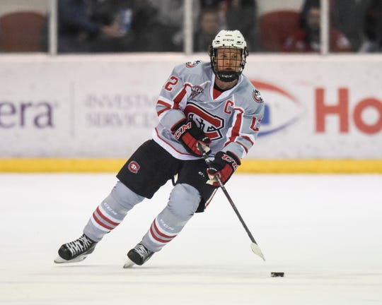 St. Cloud State senior Jack Ahcan skates with the puck Saturday, Jan. 18, 2020, at Herb Brooks National Hockey Center.